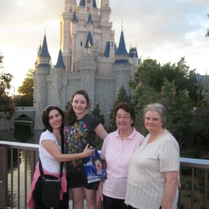 3 generations standing at Cinderella Castle